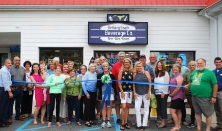 cutting ribbon bethany beach beverage co